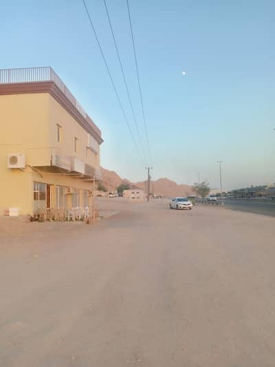 Building for Sale in Masfoot, Ajman - Building for sale on the main street-great location-all services-INCOME of 144,000 dirhams - opportunity for investment