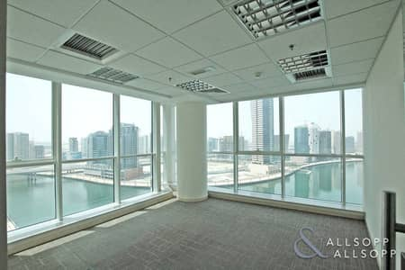Office for Sale in Business Bay, Dubai - Nice Views | Fitted partitions | Mid Floor