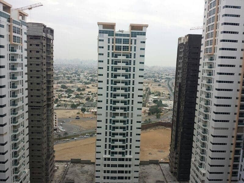 STYLISH ONE BEDROOM PLUS HALL FOR RENT IN AJMAN ONE TOWERS WITH CAR PARKING ONLY FOR 24000 IN FOUR CHEQUES. . .