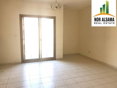 Studio for Rent in International City, Dubai - studio with balcony for rent in spain cluster in 18000