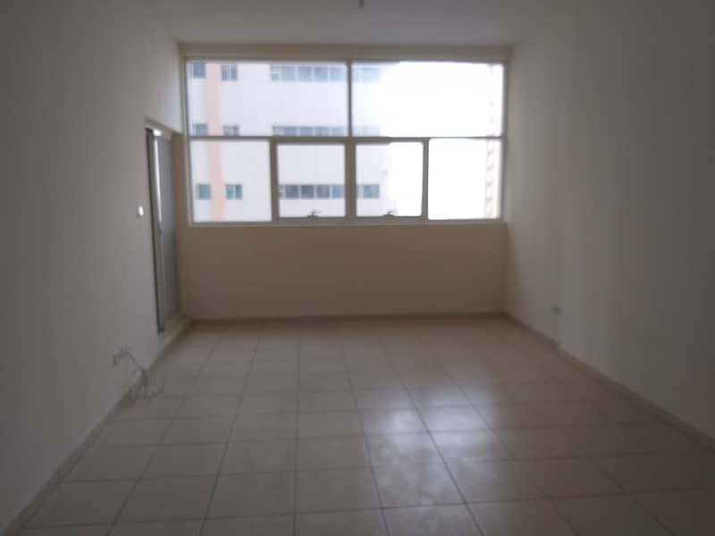 One bedroom and hall for rent in ajman one tower with parking and partial sea view very neat and clean flat