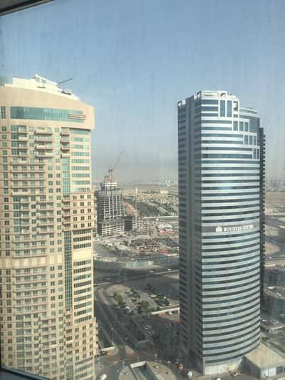 فلیٹ 1 غرفة نوم للايجار في أبراج بحيرات الجميرا، دبي - شقة في أبراج بحيرات الجميرا 1 غرف 40000 درهم - 4708377