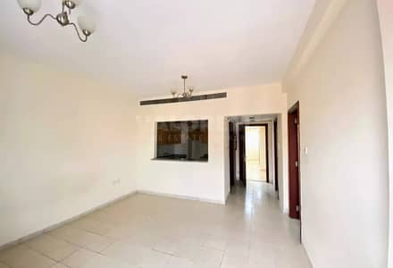 1 Bedroom Apartment for Rent in International City, Dubai - Spacious 1 BHK with Balcony|Fully Equipped Kitchen