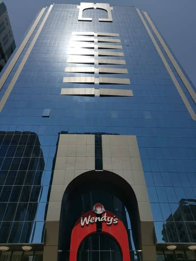 2 Bedroom Apartment for Rent in Hamdan Street, Abu Dhabi - 2 Bedroom Flat in Hamdan Tower, Prime Location - Abu Dhabi