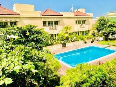 Very nice 4 bedroom villa with shared pool and pvt garden in Umm Suqeim 2