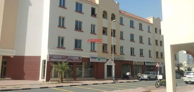 محل تجاري  للبيع في المدينة العالمية، دبي - Best Deal // Shop For Sale In England Cluster (X-Building)