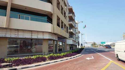Other Commercial  للايجار في جميرا، دبي - Main Road Showroom/Shop in AL Wasl Road