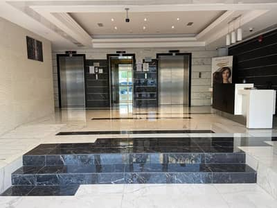 Tower Building Spacious 1 Bedroom&2 Bathrooms with Car Parking Airport Road Corniche .