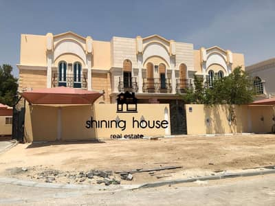 4 Bedroom Villa Compound for Sale in Khalifa City A, Abu Dhabi - For sale two villas in Khalifa A on an area of 100 in 100 public street