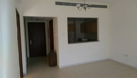 1 Bedroom Flat for Sale in International City, Dubai - BEST PRICE ONE BEDROOM APARTMENT FOR SALE ONLY 295000 WITH BALCONY