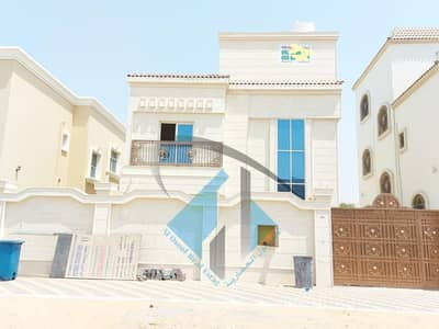 4 Bedroom Villa for Sale in Al Yasmeen, Ajman - For sale a villa in Ajman facing a stone on a running street without initial payment and in monthly installments for a period of 25 years with a large bank indulgence
