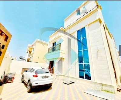 5 Bedroom Villa for Sale in Al Yasmeen, Ajman - For sale a villa in Ajman facing a stone on a running street without initial payment and in monthly installments for a period of 25 years with a large