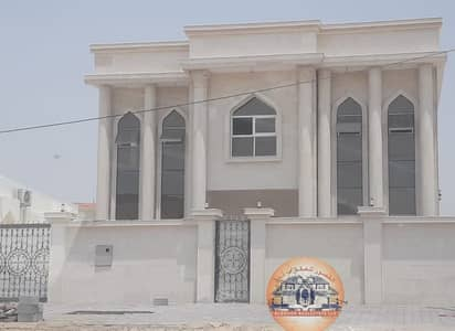 5 Bedroom Villa for Sale in Al Rawda, Ajman - Stone front villa on a street and a luxury personal finishing track