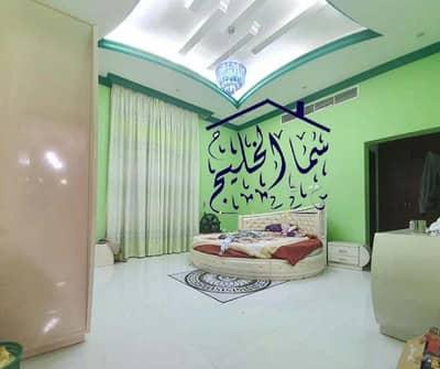 فیلا 5 غرف نوم للبيع في المويهات، عجمان - للبيع مع الكهرباء تكييف مركزي واجهه حجر قريبة جدا من شارع الشيخ عمار