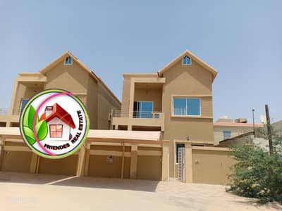 5 Bedroom Villa for Sale in Al Mowaihat, Ajman - The villa is characterized by a very modern design and the finishing is more than wonderful, free ownership for all nationalities directly from the owner next to all services with the lowest bank interest