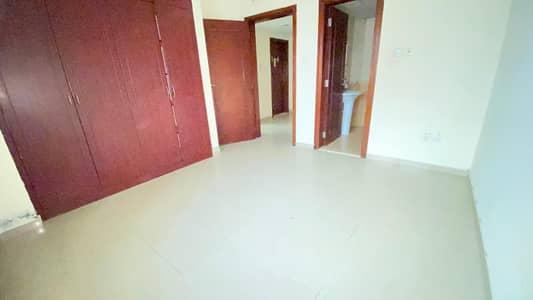 شقة 2 غرفة نوم للايجار في النهدة، الشارقة - شقة في بناية جاردن بلازا النهدة 2 غرف 35000 درهم - 4722010