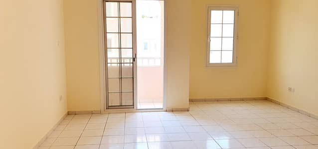 Studio for Rent in International City, Dubai - Italy Cluster Spacious Studio with balcony for Rent