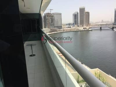 فلیٹ 1 غرفة نوم للايجار في الخليج التجاري، دبي - Huge One Bedroom Fully Furnished   High Floor   Water's Edge