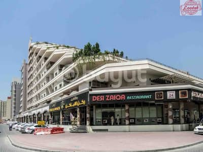 Shop for Rent in Al Qusais, Dubai - Affordable Shop for Rent in Al Tasaheel Building