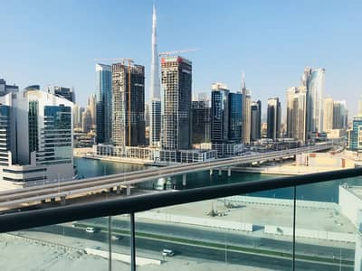 شقة 1 غرفة نوم للايجار في الخليج التجاري، دبي - شقة في برج السفير 2 الخليج التجاري 1 غرف 45000 درهم - 4728364
