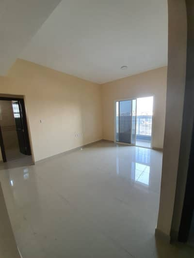 1 Bedroom Flat for Rent in Al Jurf, Ajman - Hall with Balcony
