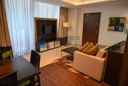 شقة 1 غرفة نوم للايجار في مدينة دبي الرياضية، دبي - Elegant fully furnished 1BR in Matrix Tower