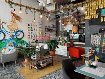محل تجاري  للايجار في الخليج التجاري، دبي - Fitted Retail Shop with Coffee Shop Business