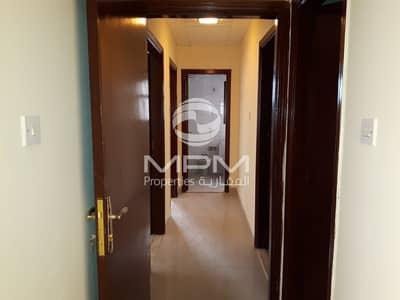 فلیٹ 2 غرفة نوم للايجار في شارع المطار، أبوظبي - 2 BR. Apartment (window A/C) near immigration office