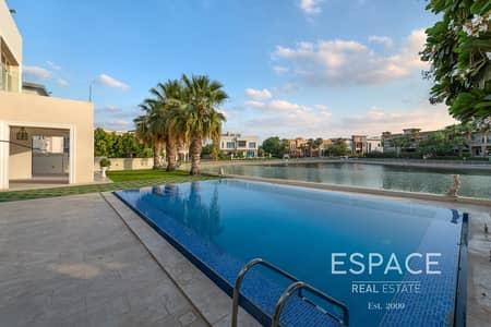فیلا 6 غرف نوم للبيع في تلال الإمارات، دبي - Luxury 6 Bed Villa Lake and Skyline Views