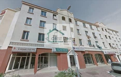 Shop for Rent in International City, Dubai - Affordable spacious shop for rent in England Cluster