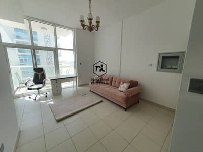 Studio for Rent in Dubai Studio City, Dubai - New Studio in Glitz 3 - Semi Furnished - Balcony & Parking - 27K by 1 Cheque