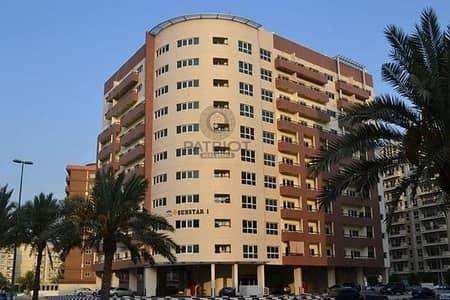 فلیٹ 1 غرفة نوم للايجار في المدينة العالمية، دبي - best deal:1 bhk with balcony in cbd full facility building just 30k