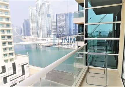 Spacious 1BR Apartment with Partial Canal View