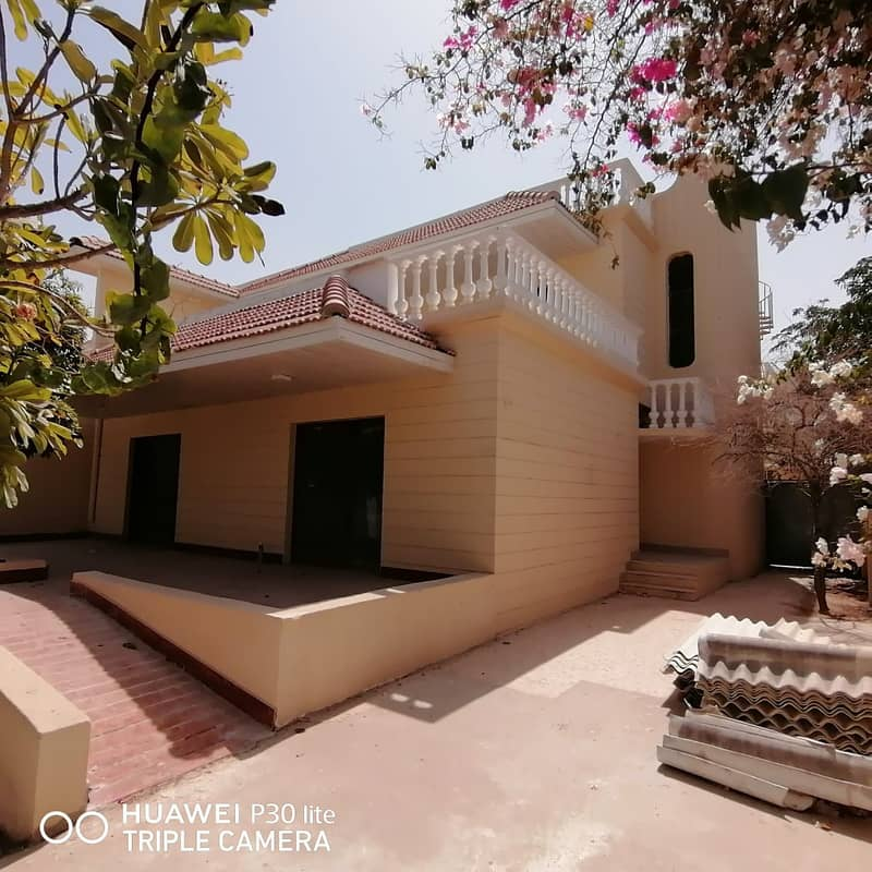 A HUGE 4 BEDROO PLUS HALL PLUS MAJLIS WITH MAID E=ROOM VILLA IS AVAILABLE IN 90K WITH 4 CHQs IN SHARQAN SHARJAH