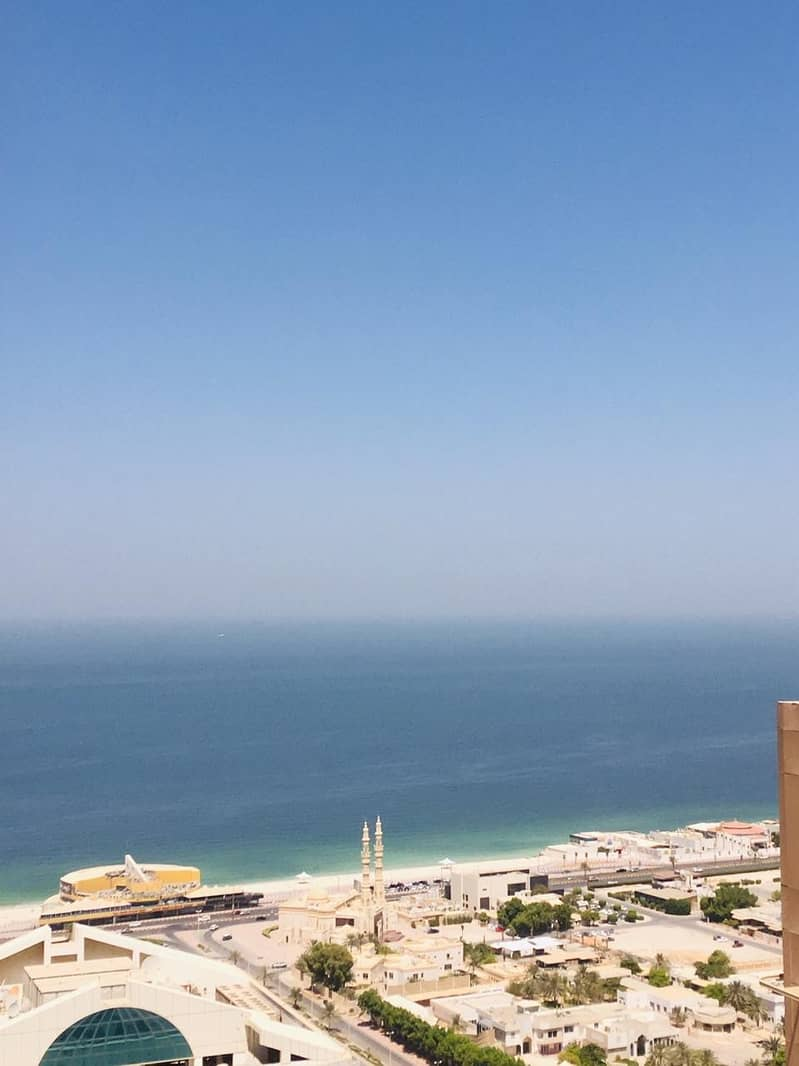 2 bhk partial sea view  biggest size with 2 store and parking in Ajman one tower