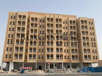 مبنى سكني  للبيع في مجمع دبي الصناعي، دبي - Brand New Building for Sale in Dubai Industrial Park | Rented | Great for Investment