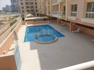 1 Bedroom Flat for Rent in Jumeirah Village Circle (JVC), Dubai - Pool view | Spacious 1 bed with Storage | Ground