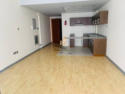 Studio for Rent in Dubai Silicon Oasis, Dubai - Spacious Studio with Wooden Floor and Balcony in DSO