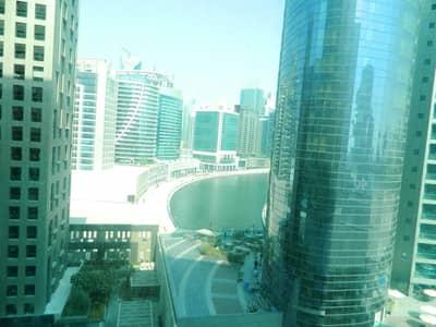 مکتب  للايجار في الخليج التجاري، دبي - Unfurnished Fitted Office|Partitioned|788 Sq.Ft.