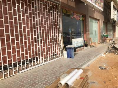محل تجاري  للايجار في عجمان الصناعية، عجمان - Shops Available and plus 2 months FREE in Industrial Area 2