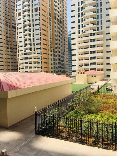 1 Bedroom Flat for Sale in Al Sawan, Ajman - 1 bhk closed kitchen garden view with parking for sale in Ajman one tower