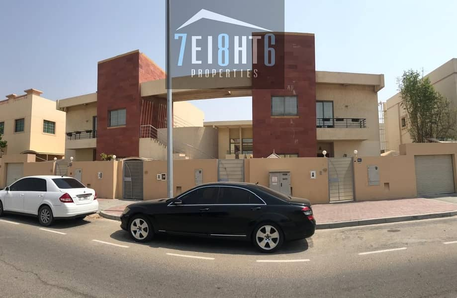 9 Excellent quality: 4 b/r semi-indep villa + maids room + sharing s/pool + large landscaped garden for rent in Mirdif