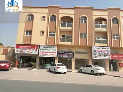 Shop for Rent in Al Rawda, Ajman - Large and different commercial stores on a main street for rent in Ajman.