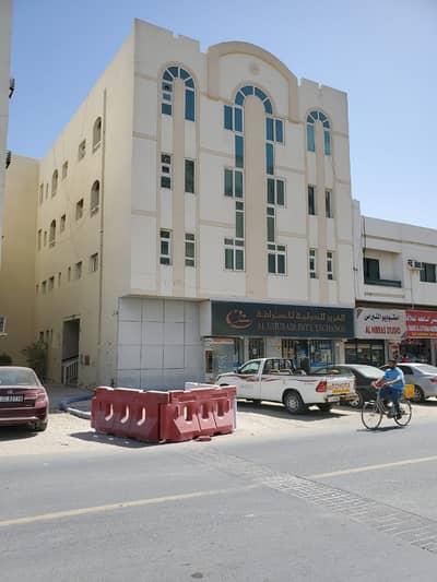 مبنى سكني  للبيع في تجارية مويلح، الشارقة - للبيع بناية منطقة مويلح التجارية بالشارقة