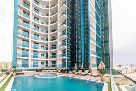2 Bedroom Apartment for Rent in Corniche Ajman, Ajman - For lovers of luxury, large areas and views of the creek for rent in the Oasis Tower, two rooms and a hall with a balcony with a private car park with free air conditioning for the owner, the first inhabitant