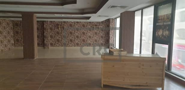 محل تجاري  للايجار في الكرامة، دبي - Fitted Restaurant with Shisha lounge