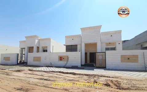 3 Bedroom Villa for Sale in Al Amerah, Ajman - Villa for sale in Ajman, Al Amerah area, ground floor, facing stone, near Emirates Road, with the possibility of bank financing