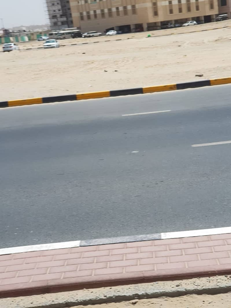 land for sale very good location iat the main road  opposite sahara center
