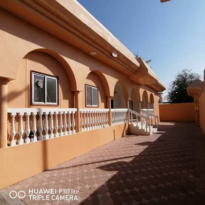 4 Bedroom Villa for Rent in Al Azra, Sharjah - A BIG 4 BHK WITH HUGE MAJLIS PLUS BIG HALL WITH MAID ROOM COVERED PARKING IS AVAILBLE IN 85K AL AZRA SHARJAH