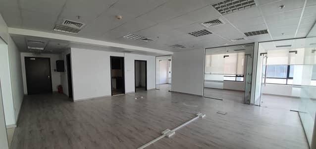 مکتب  للايجار في قرية جميرا الدائرية، دبي - Fitted with Partition Office with 2 parking for rent.